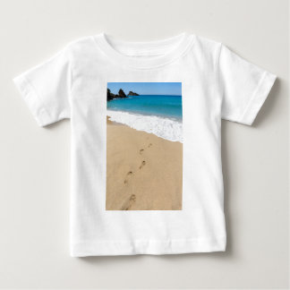 Footsteps in sandy beach leading to blue sea baby T-Shirt