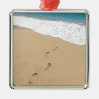 Footsteps in sandy beach leading to blue sea Silver-Colored square ornament