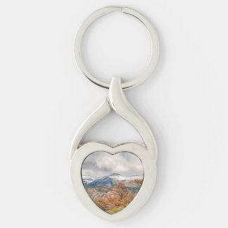 Forest and Snowy Mountains, Patagonia, Argentina Silver-Colored Twisted Heart Keychain