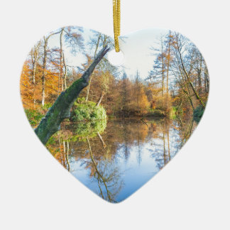 Forest autumn landscape with pond ceramic heart ornament