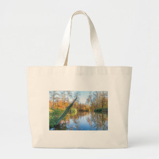 Forest autumn landscape with pond large tote bag