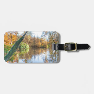 Forest autumn landscape with pond luggage tag
