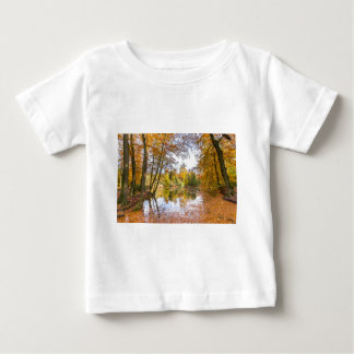 Forest pond covered with leaves in winter season baby T-Shirt