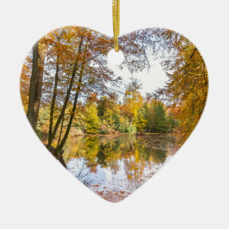 Forest pond covered with leaves in winter season ceramic ornament