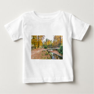 Forest with pond and bridge in fall colours baby T-Shirt