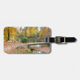 Forest with pond and bridge in fall colours luggage tag