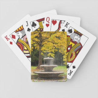 Fountain by a tree in fall, Germany Poker Deck