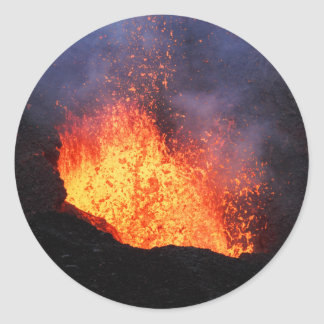 Fountain of hot lava erupts from crater volcano classic round sticker