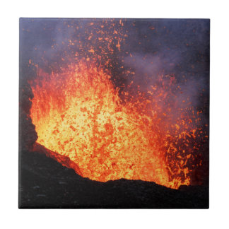 Fountain of hot lava erupts from crater volcano tiles