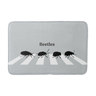 Four beetles walking across a crosswalk in London… Bath Mat