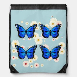 Four blue butterflies drawstring bag