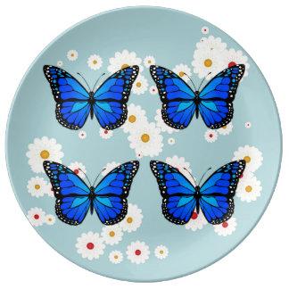 Four blue butterflies plate