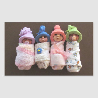 Four Clay Babies, Swaddled, With Hats Sticker