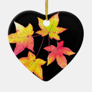 Four colored autumn leaves on black background ceramic heart ornament