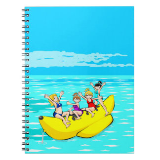 Four girls laughing in a boat banana notebook