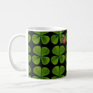 Four-leaf clovers and ladybug coffee mug