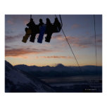 Four snowboarders are silhouetted on a ski lift print