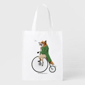 Fox on bike grocery bags