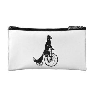 Fox Riding a Bike Makeup Bags