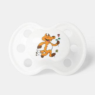 Fox running with a flower pacifier
