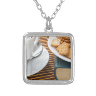 Fragment of a saucer with a cup of tea silver plated necklace