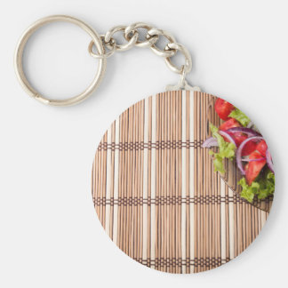 Fragment of a transparent plate of fresh salad basic round button keychain