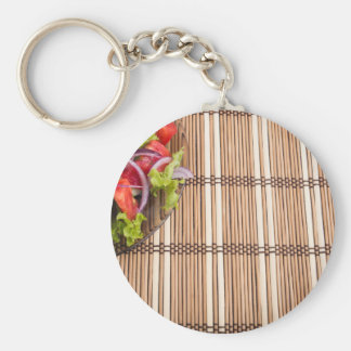 Fragment of transparent plate of fresh vegetarian keychain