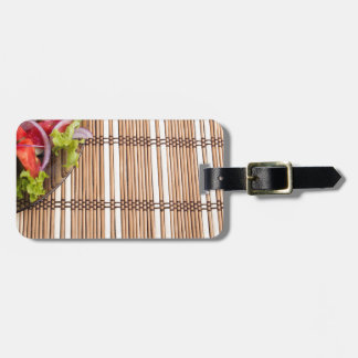Fragment of transparent plate of fresh vegetarian luggage tag