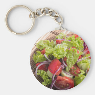 Fragment of vegetarian salad from fresh vegetables basic round button keychain