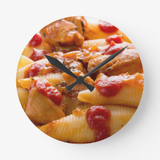 Fragment portion conchiglioni pasta and turkey round clock