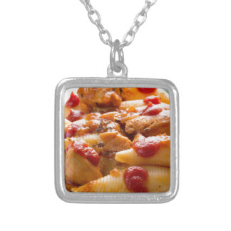 Fragment portion conchiglioni pasta and turkey silver plated necklace