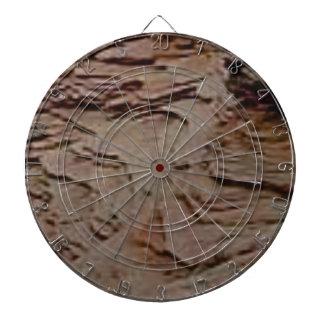 fragments chips in rock dartboard