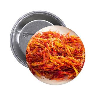 Fragrant saffron close-up 2 inch round button