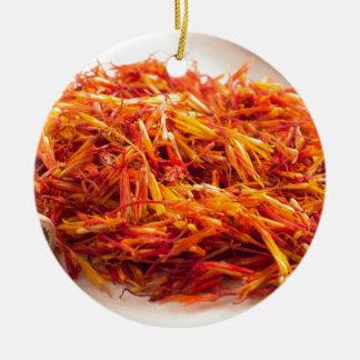 Fragrant saffron close-up round ceramic ornament