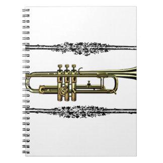 framed trumpet in gold spiral notebooks