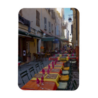 France, Corsica. Tables of cafe set up in narrow Rectangular Photo Magnet