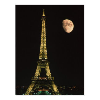 France, Paris. Eiffel Tower at night with Postcard