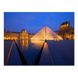 France, Paris. The Louvre museum at twilight. Postcard