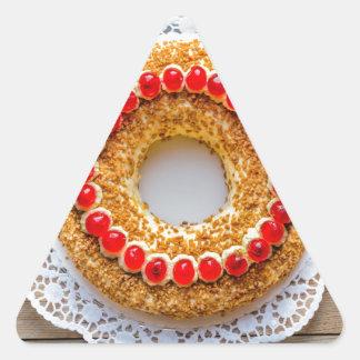 Frankfurt crown cake with cherries on rustic wood triangle sticker