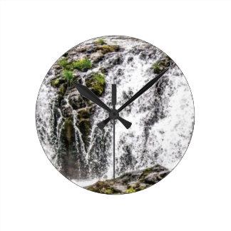 free flowing falls round clock