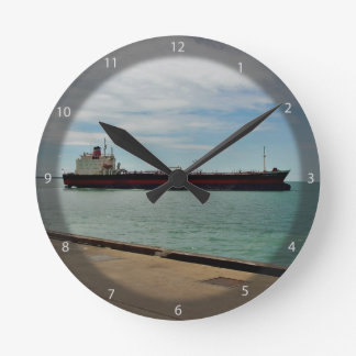 Freighter ship sailing on sea round clock