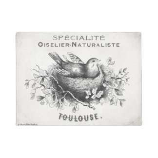 French vintage style doormat with bird in nest.