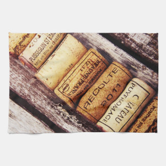 french wine bottle corks on rustic wooden texture kitchen towel