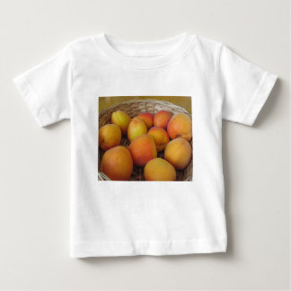 Fresh apricots in a wicker basket baby T-Shirt