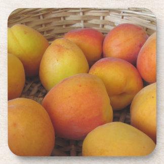 Fresh apricots in a wicker basket coaster