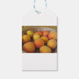 Fresh apricots in a wicker basket gift tags
