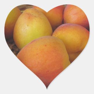 Fresh apricots in a wicker basket heart sticker