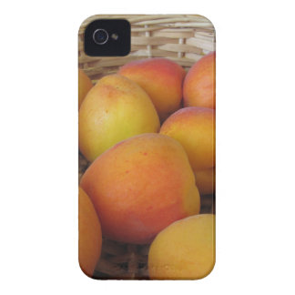Fresh apricots in a wicker basket iPhone 4 case