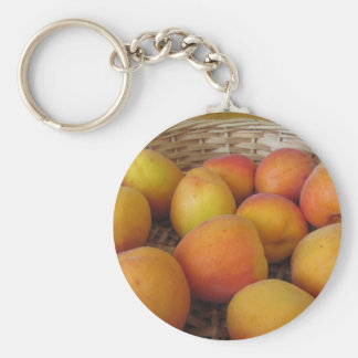 Fresh apricots in a wicker basket keychain