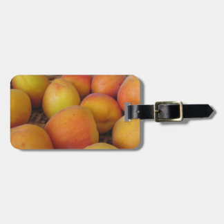 Fresh apricots in a wicker basket luggage tag
